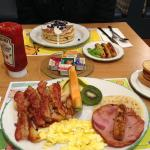 Cora's Special & Blueberry Pancakes with a side of sausages