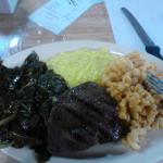 Steak, collards, creamed corn, and macaroni