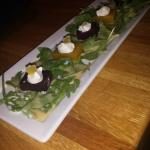 Beet salad-compressed beets, goat cheese mousse, candied ginger, arugula, miso honey vinaigrette