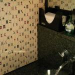 Ladies room wall is tiled with Mah Jong tiles!