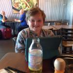 A kid enjoying Cantina Grill's quesadilla and DEN free wifi.