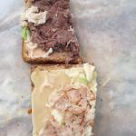 """Simply Gourmet """"Giant"""" sandwich, supposed to be turkey, roast beef, Swiss cheese and coleslaw. W"""