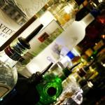 Bottles on lighted shelf