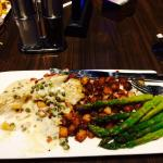 Sauteed Walleye covered with white sauce and served with potatoes & asparagus
