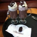 Yummy hot chocolates with cream, marshmallows and flakes plus choc side order
