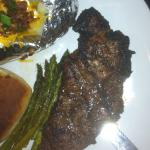 Steak with baked potato and asparagus