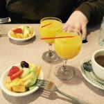 Breakfast fruit salad and mimosas