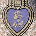 Purple Heart depicted on the marble bench.