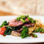 Roasted lamb rump with a pea & mint gravy