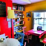 Upstairs seating room with books for sale, bright and cheerful.