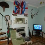 Living room with flags of different visitor's countries.  Their flag is flown out front.