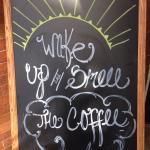 Sign outside cafe door.