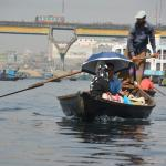 punting across the river in Dhaka