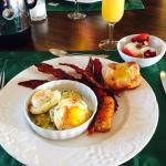 Poached eggs with artichoke sauce, brown sugared bacon, chicken sausage, Greek yogurt with walnu