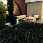 Nice outdoor sitting area with fire.