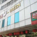 "Front of hotel with ""U-Green"" sign"