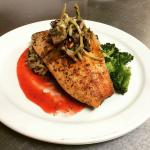 Butter poached rainbow trout over a strawberry purée, wild rice and sautéed broccoli and topped