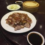 Full plate of duck with crispy skin