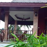 top balcony with rocking chair with oceanview and dinning table to enjoy the breeze