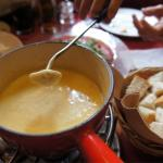 Cheese fondue, comes with bread and small potatoes.
