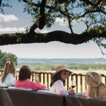 Sip wine on the patio at Pedernales Cellars and enjoy the Texas Hill Country views.