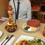 Hanging kebab and king prawn and Mexican rice
