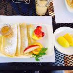 Crepes with lemon, butter, powdered sugar and a little fruit. Add syrup if you like.
