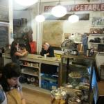 The register area, the owner Tarah is in the background. Antiques all over the walls. Fun!
