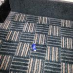 Poor cleaning crew, bottle cap in plain sight on the floor