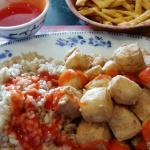 Sweet and sour tofu with brown rice and sauce on the side. The rice and tofu were cooked perfect