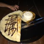 Thai banana pancake with chocolate sauce and honey with chocolate chip ice cream