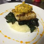 Grilled Kingklip on Mash potatoe wiltered spinach and a herb Butter.