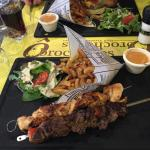 Chicken and beef skewers with amazing fries , side sauce to die for and salad.