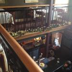 looking down from the upstairs dining area to the bar on the main floor