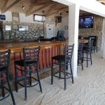 Inside Mackey's - sand floor and tv's