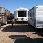 RVs crowded in an overflow lot