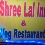 Sign displaying Shree Lal Inn