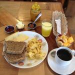 Breakfast option Alemania. fresh integral German bread, Real Swiss cheese, Nutella, fruit, coffe