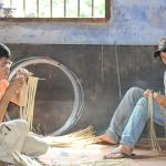 Family working on the guts of the lantern..bamboo