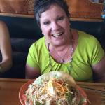 My Mom with her food, their servings are HUGE