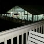 View of the indoor heated pool at night. Hours are 10am-10pm.