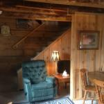 """""""Jack London's Cabin"""" living/dining room with stair case to 2nd floor"""