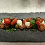 Sun-blush and cherry tomatoes, marinated olive and boconcinni mozerella, basil and rocket
