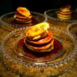 Peanut Butter Banana Pancakes - a mini stack of pancakes topped with whipped peanut butter & ban