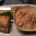 Seafood combo with shrimp and lobster in garlic butter sauce with scalloped potatoes and veggies