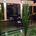 Indoor section with water/pond in middle of restaurant - tables against window