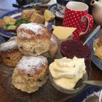 Delicious scones with clotted cream and jam