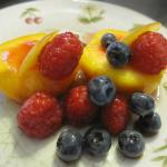 Poached peaches with raspberries and blueberries