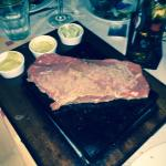Steak on a stone . It's a sirloin but you can ask for a better cut