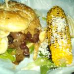The Memphis burger with an ear of Blue's Corn